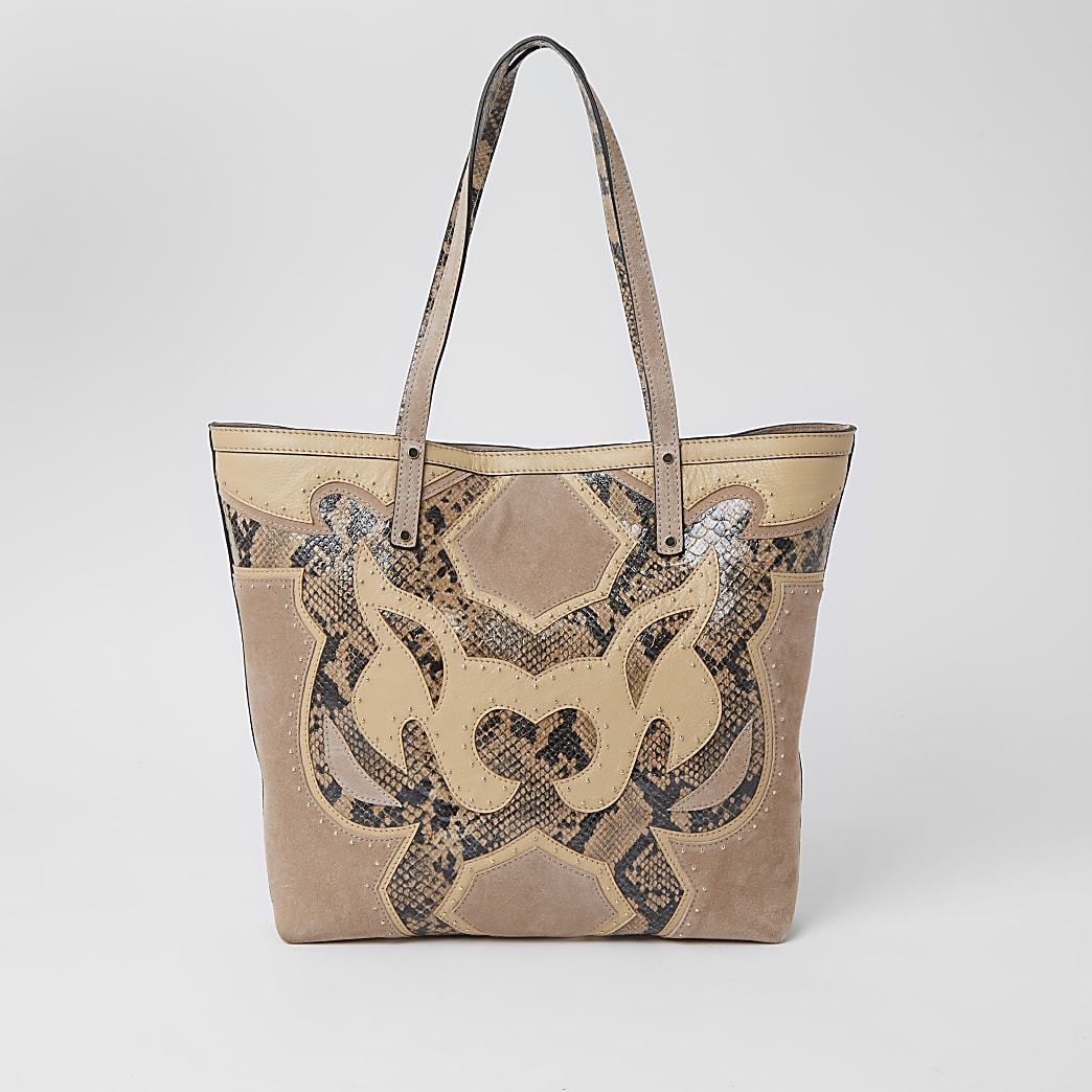 Beige leather studded western tote bag