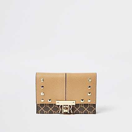 Beige mini stud foldover purse