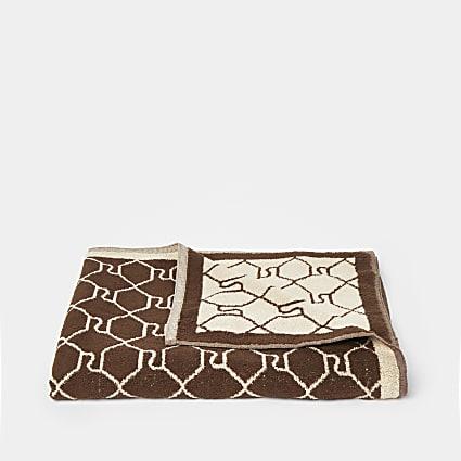 Beige monogram beach towel