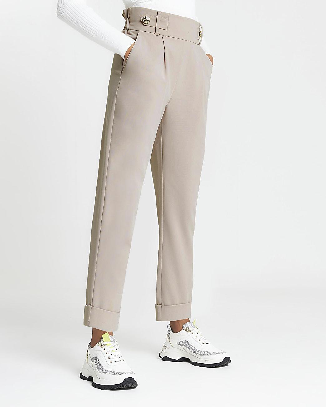 Beige pleated peg leg trousers