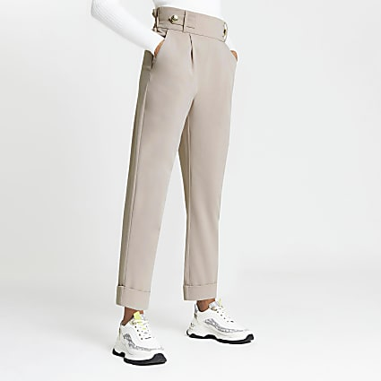 Beige pleated peg leg trousers