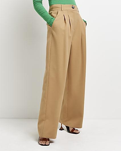 Beige pleated wide leg trousers