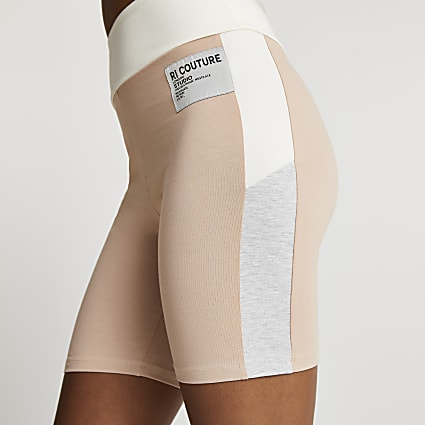 Beige RI Couture cycling shorts