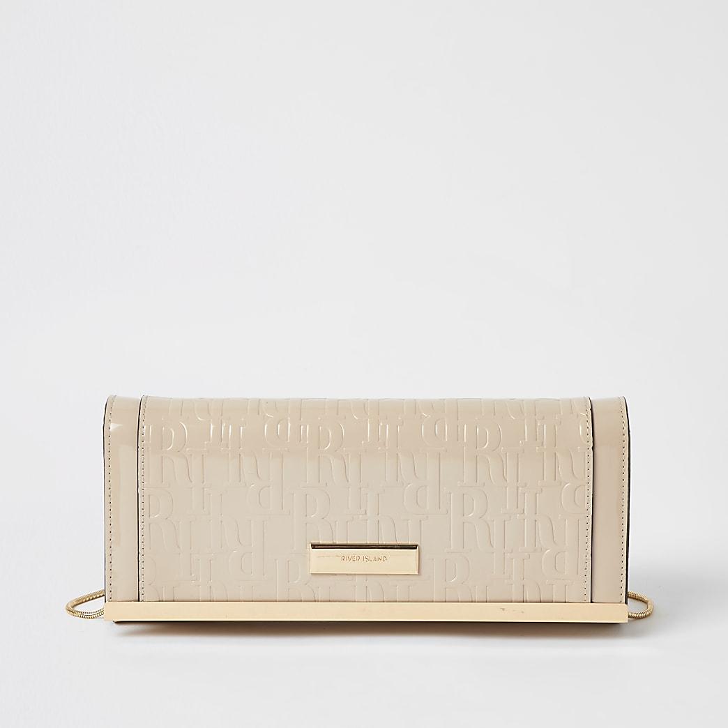 Beige RI patent embossed clutch bag