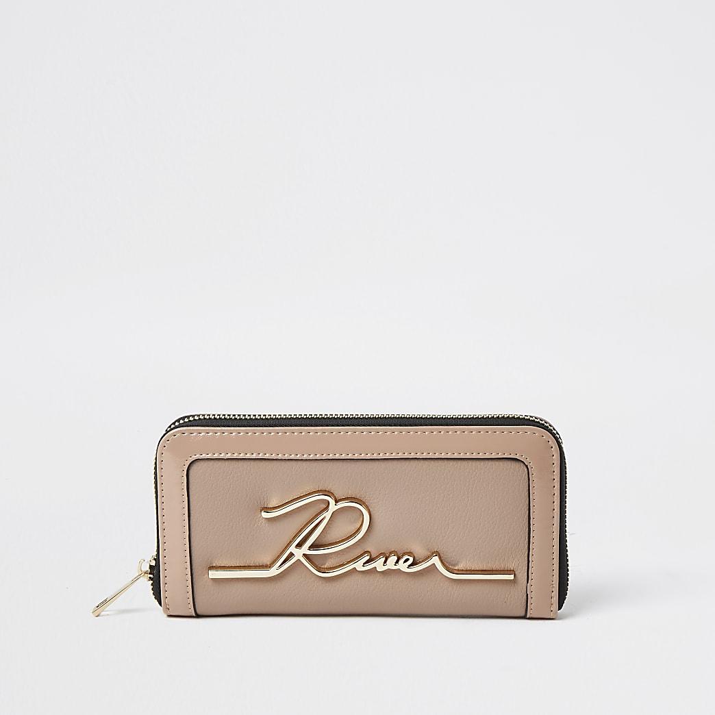 Beige RI zip around purse