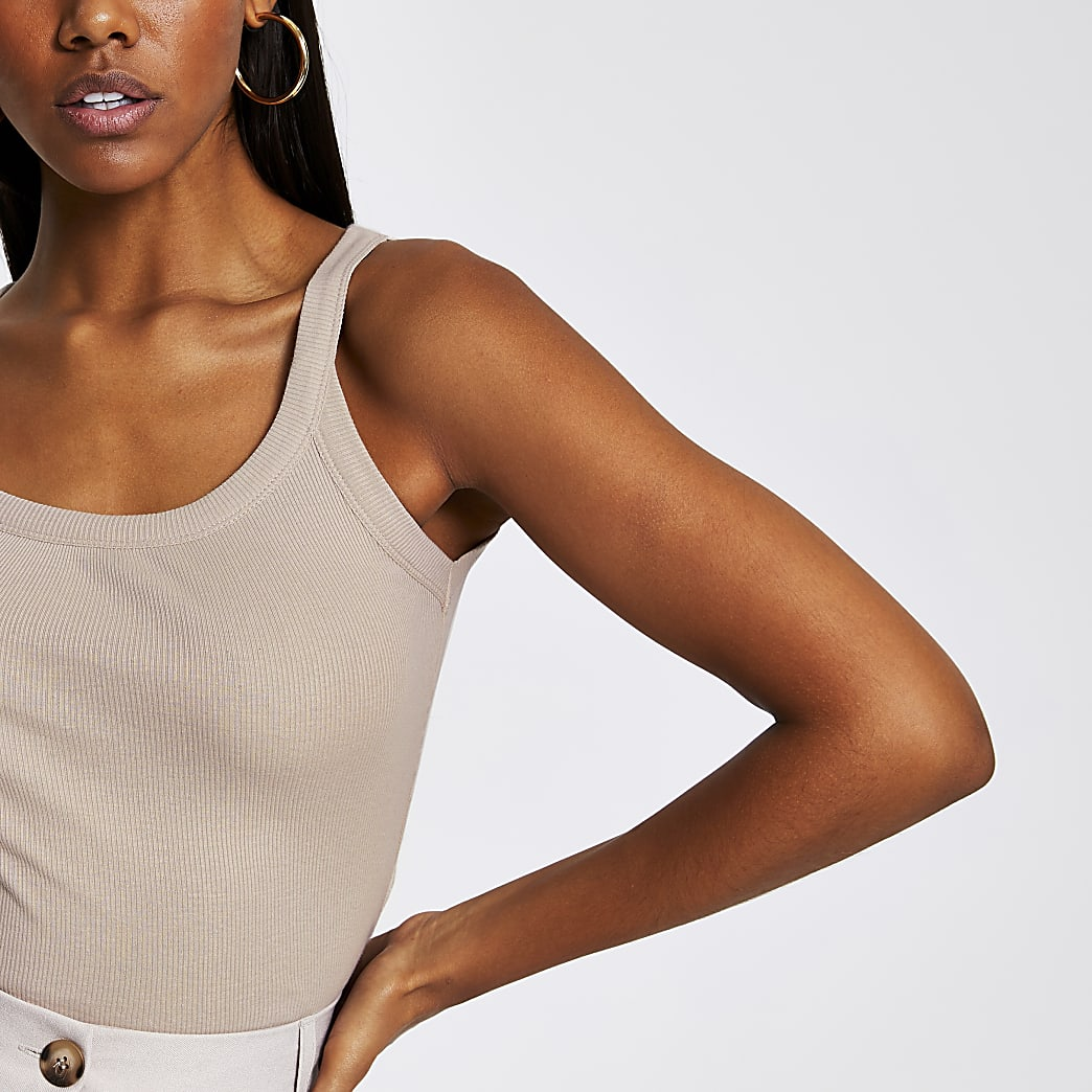Beige ribbed v neck fitted vest