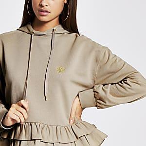 Beige hoodie met ruche aan de zoom en RVR-print
