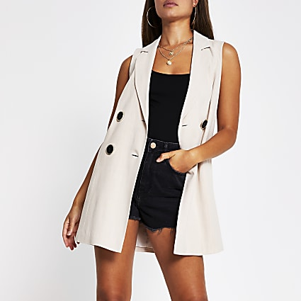 Beige sleeveless button up blazer