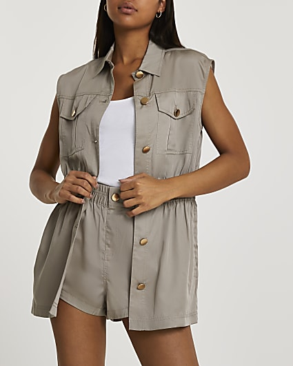 Beige sleeveless cinched waist jacket