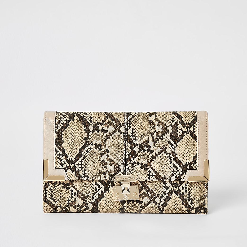 Beige snake print fold over travel wallet