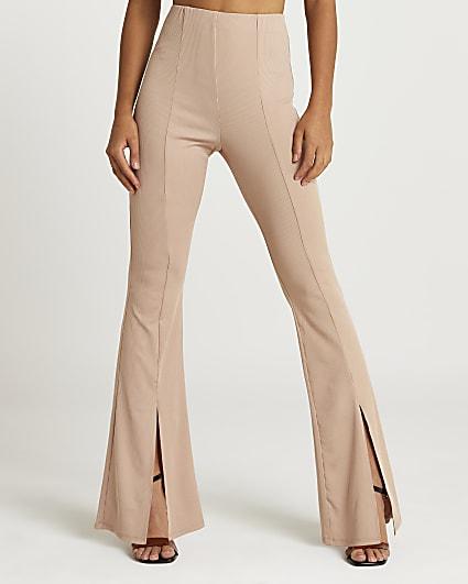 Beige split front flared trousers