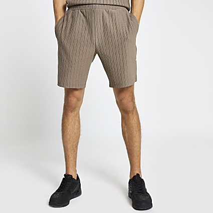 Beige textured ribbed slim fit shorts
