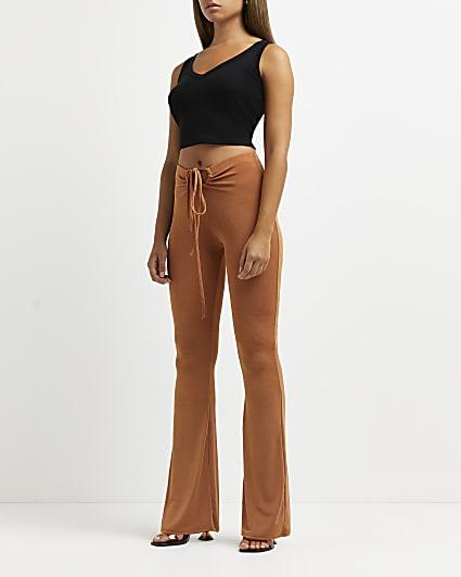 Beige tie detail flared trousers