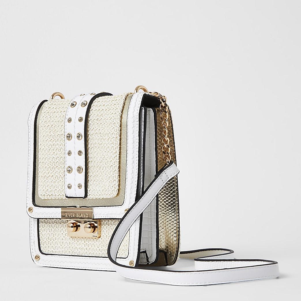Beige vertical cross body handbag