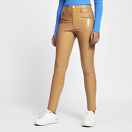 Beige vinyl super fitted trousers