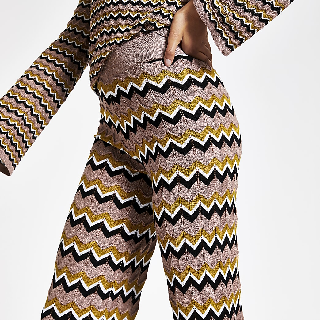 Beige zig zag print knitted trousers