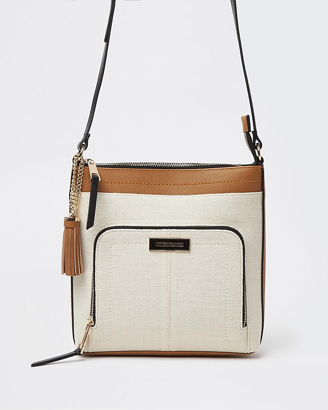 Beige zip pocket messenger bag