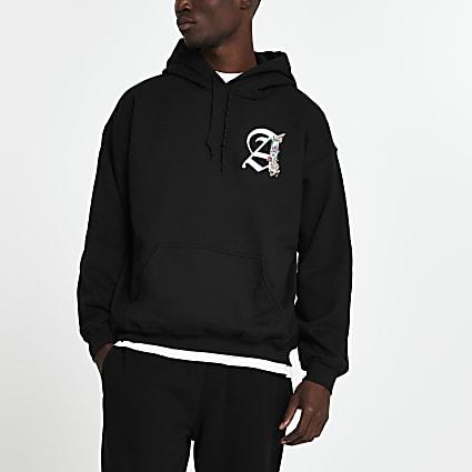 Black 'A' floral print slim fit hoodie