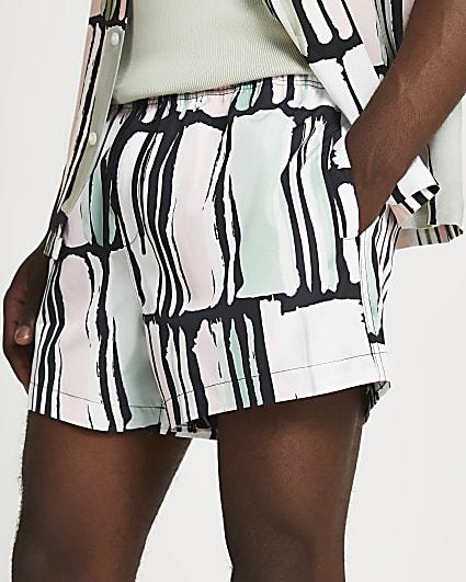 Black abstract print swim shorts