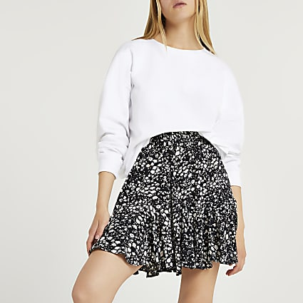 Black animal print mini skirt
