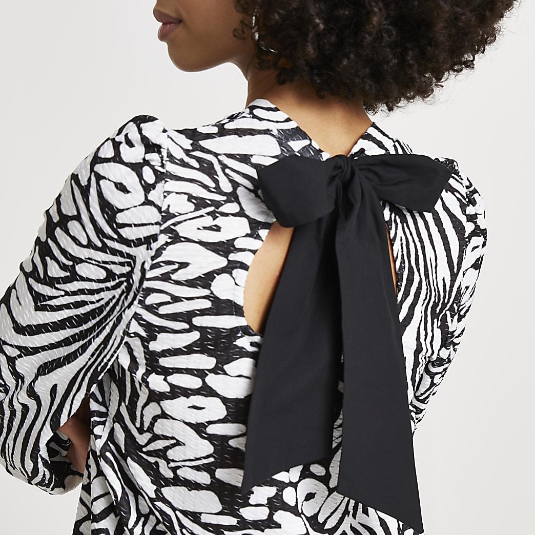 Black animal print puff sleeve tie back top