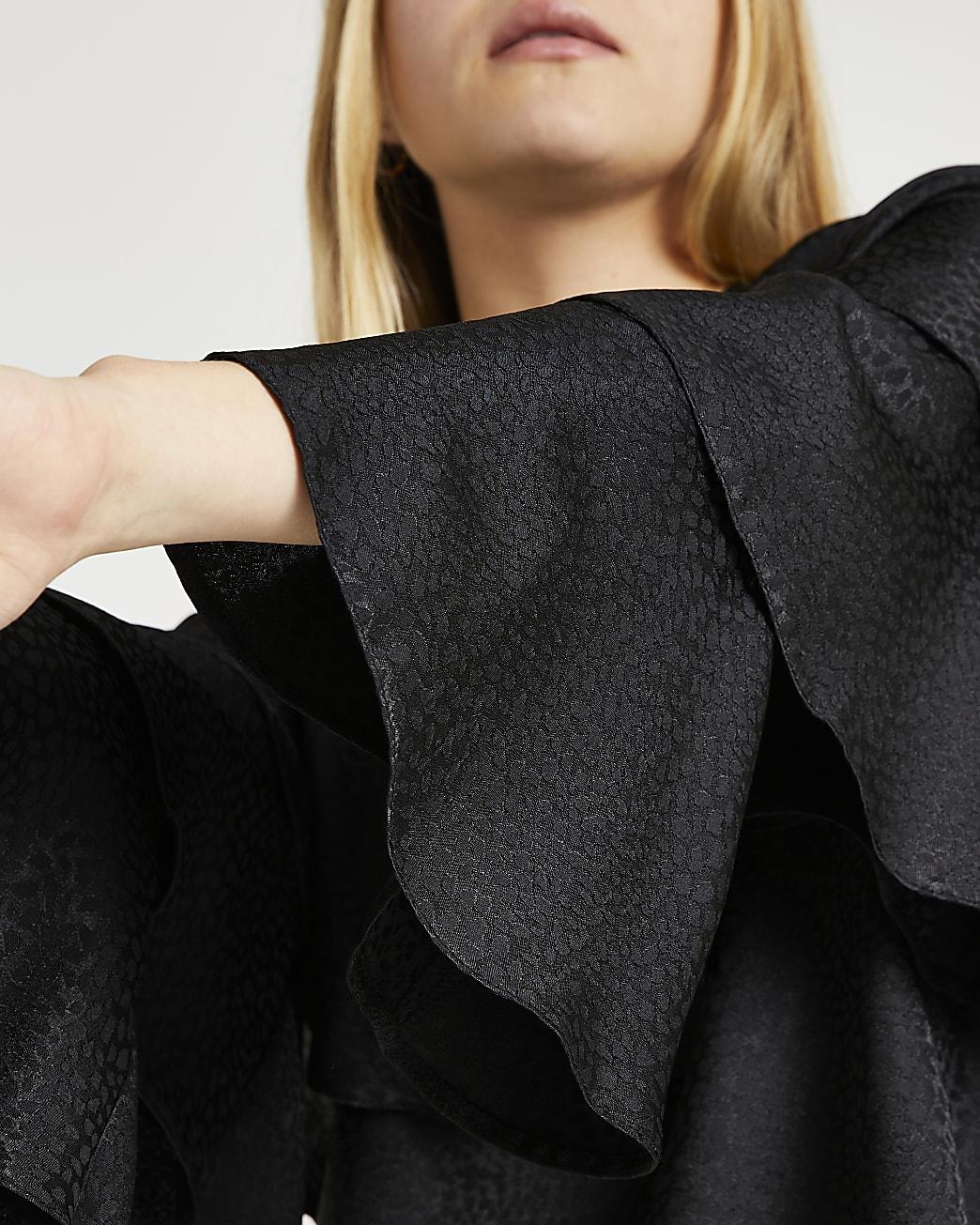 Black animal print ruffle blouse top