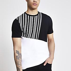 Zwart slim-fit T-shirt met asymmetrische kleurvlakken