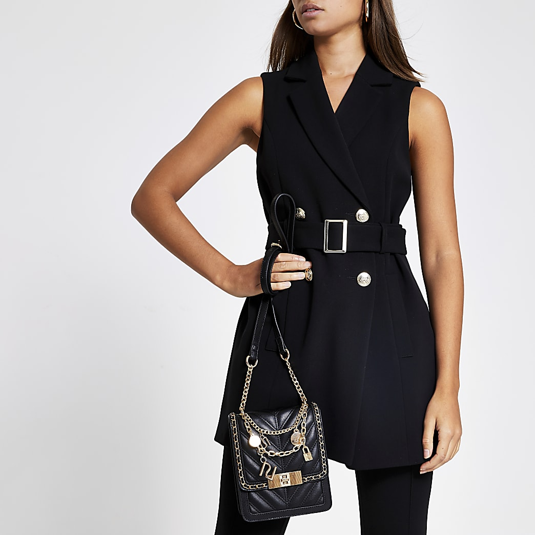 Black belted sleeveless blazer