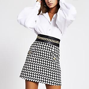 Mini jupe à carreaux ceinturée avec chaînenoire
