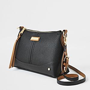 Zwarte crossbodytas met gespen aan de zijkant