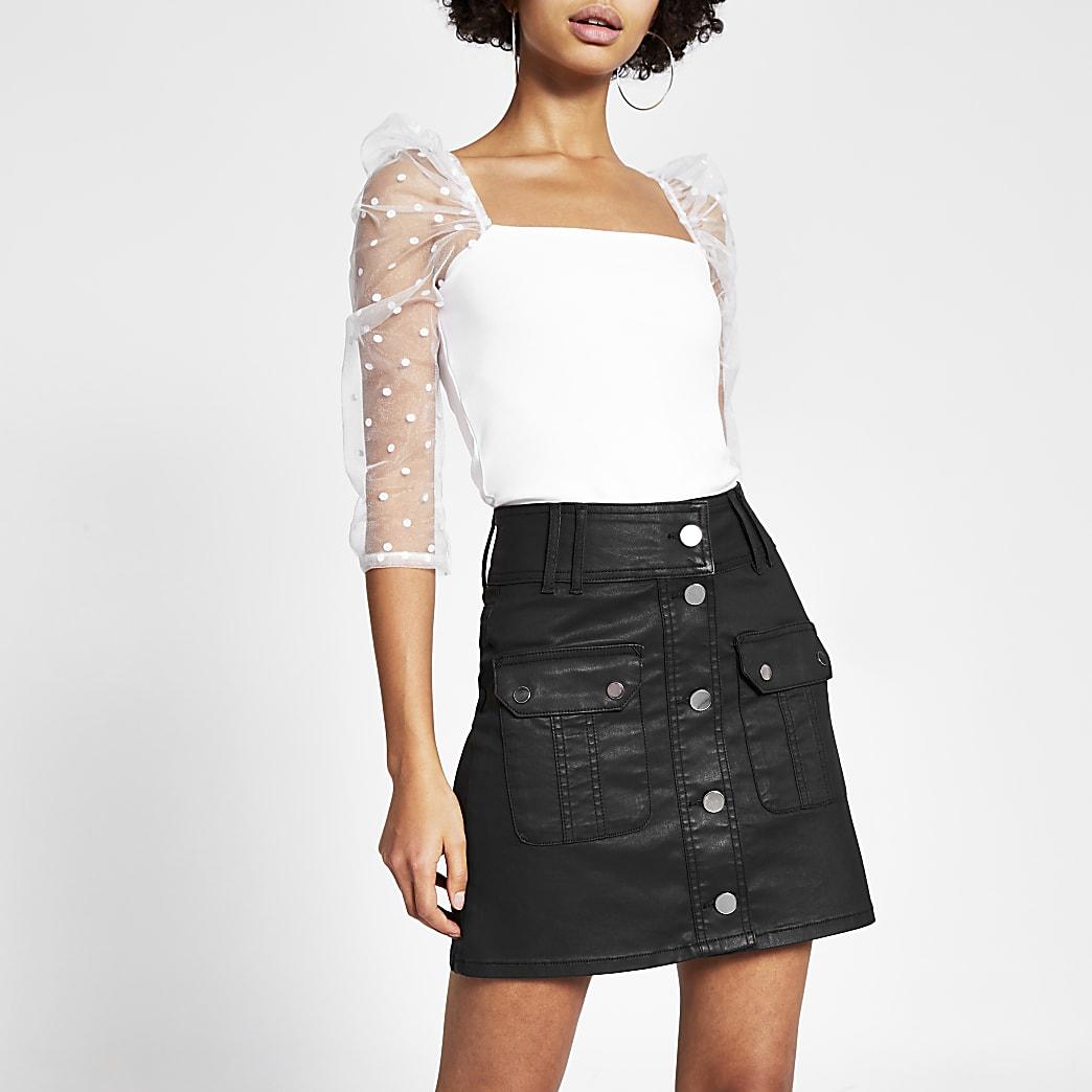 Black coated button front denim mini skirt