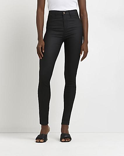 Black coated high waisted skinny jeans