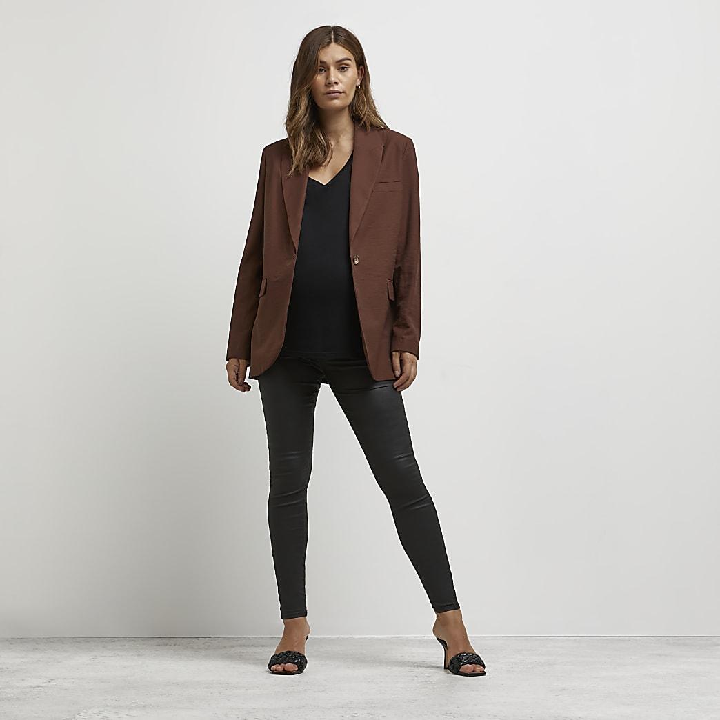 Zwarte coating Molly zwangerschapsjeggings met tailleband boven de buik