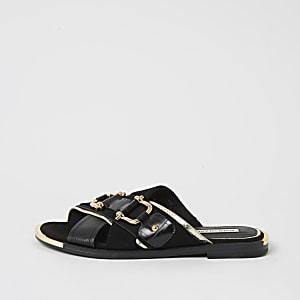 Schwarze Sandalen mit überkreuzten Trensen-Riemen