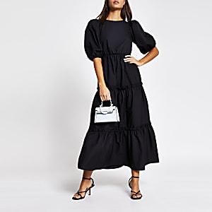 Zwarte gesmokte midi-jurk met gekruisde strik achter
