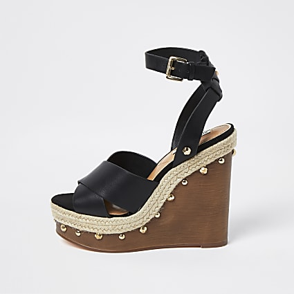 Black cross wooden wedge heels