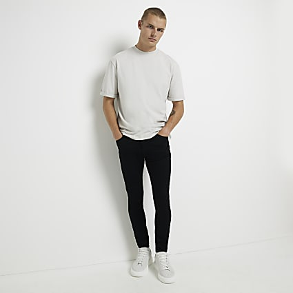 Black crow spray on skinny jeans