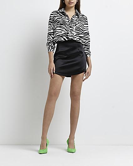 Black curved hem mini skirt