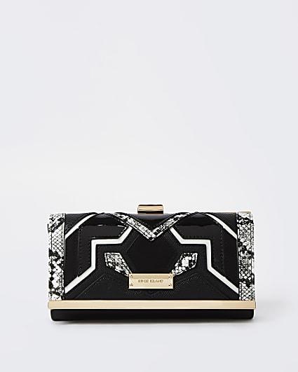 Black cut out clip top purse