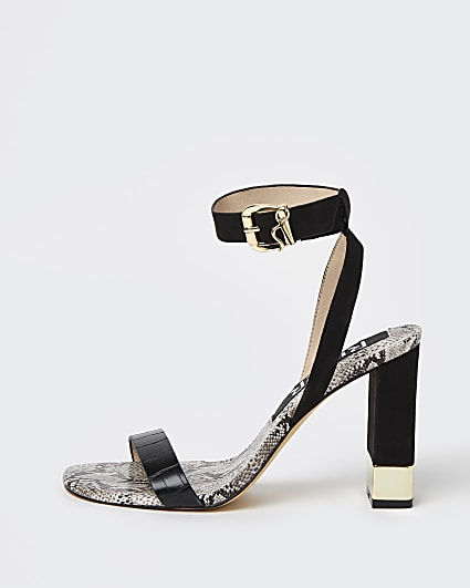 Black embossed block heels