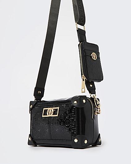 Black embossed cross body bag