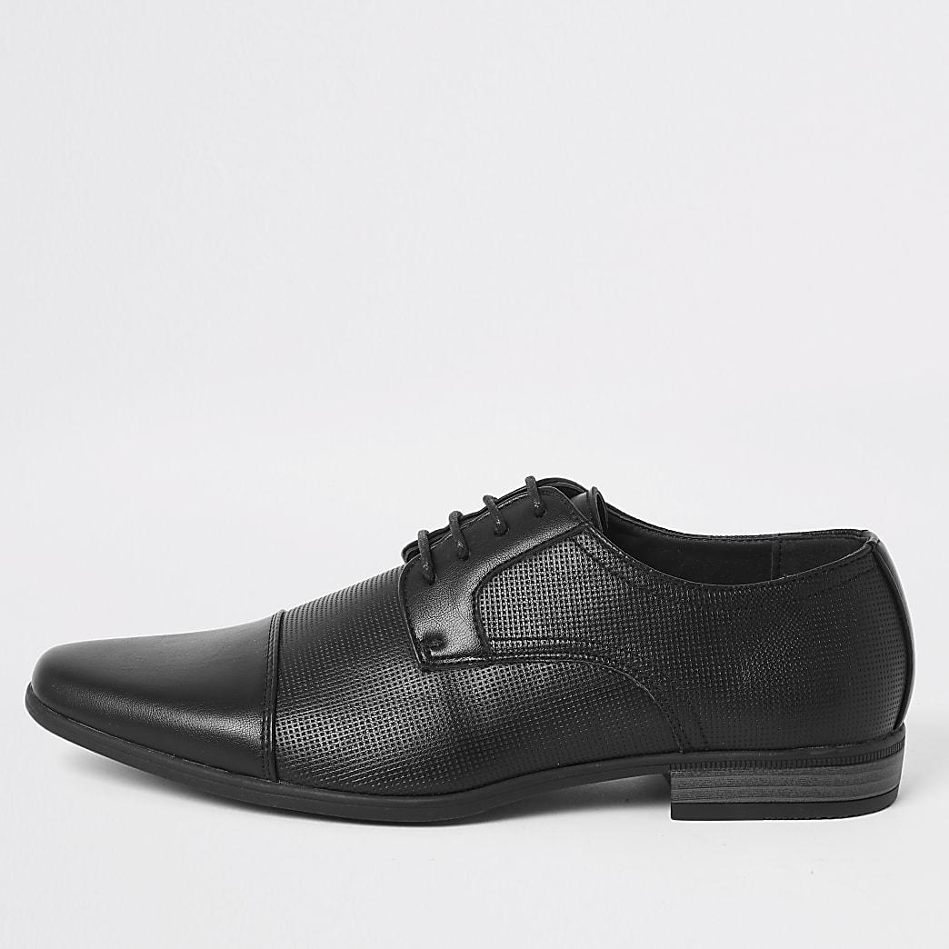 Chaussures Derby noires lacées en relief
