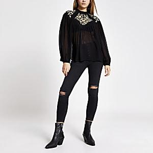 Zwarte geborduurde doorschijnende blouse met lange mouwen