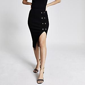 Jupe mi-longue ajustée avec lacetsà œillets noire