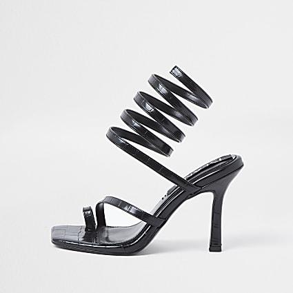 Black faux leather ankle wrap heels