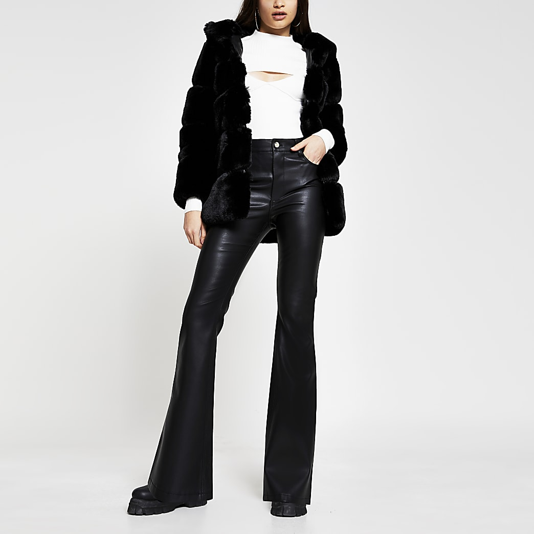 Black faux leather bootleg trousers