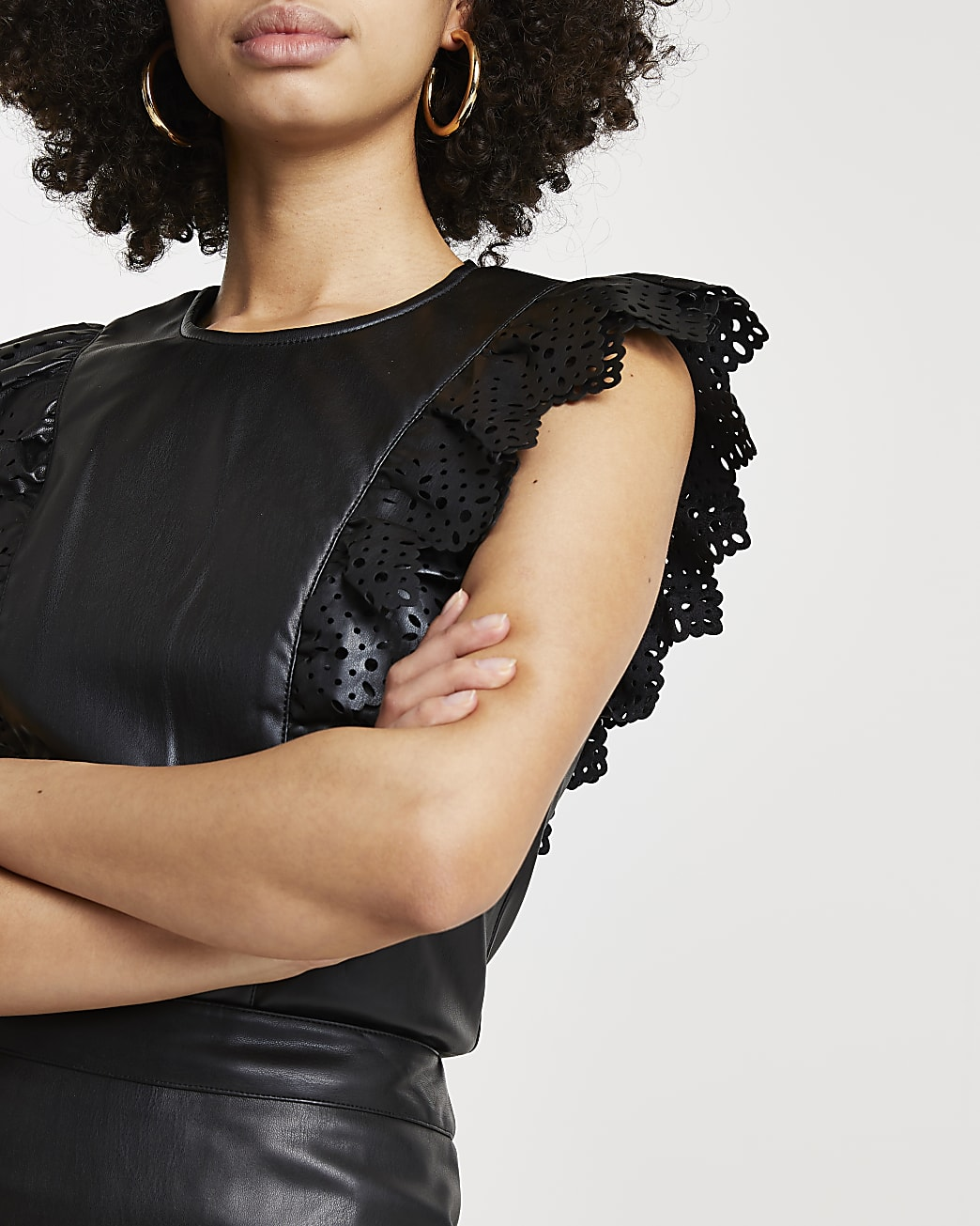 Black faux leather cutwork frill top