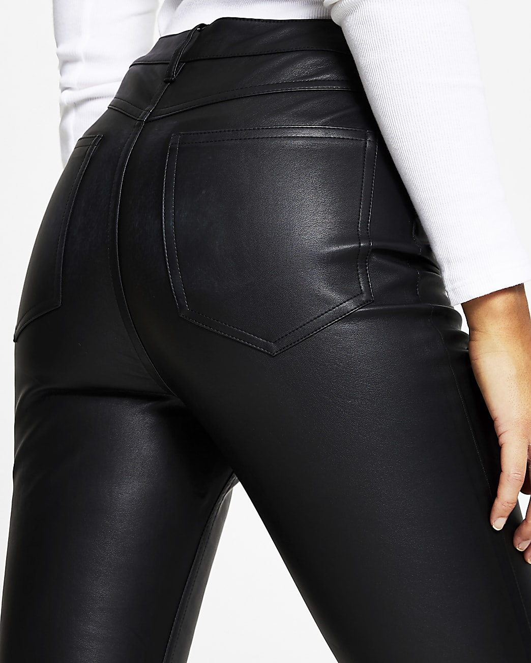 Black faux leather flared trousers