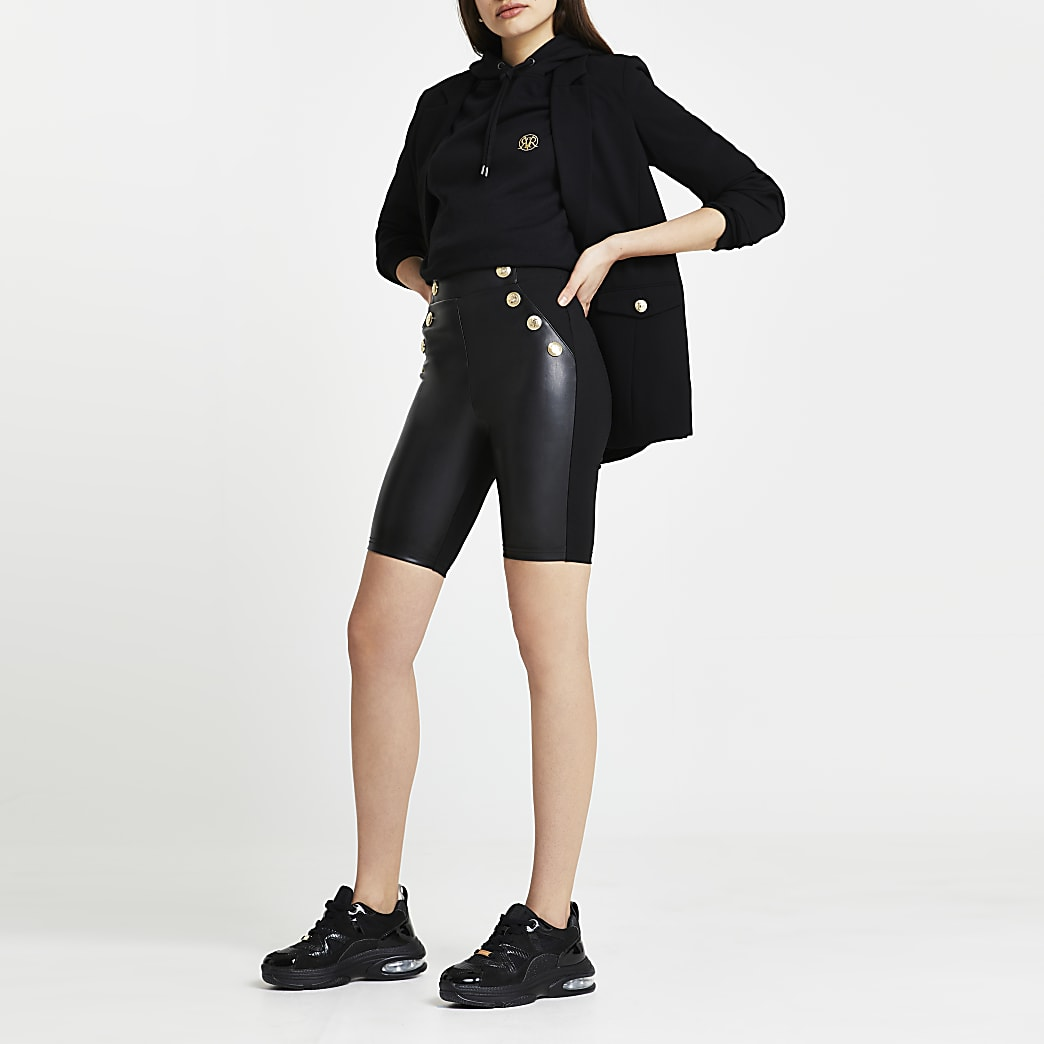 Black faux leather gold button cycling shorts