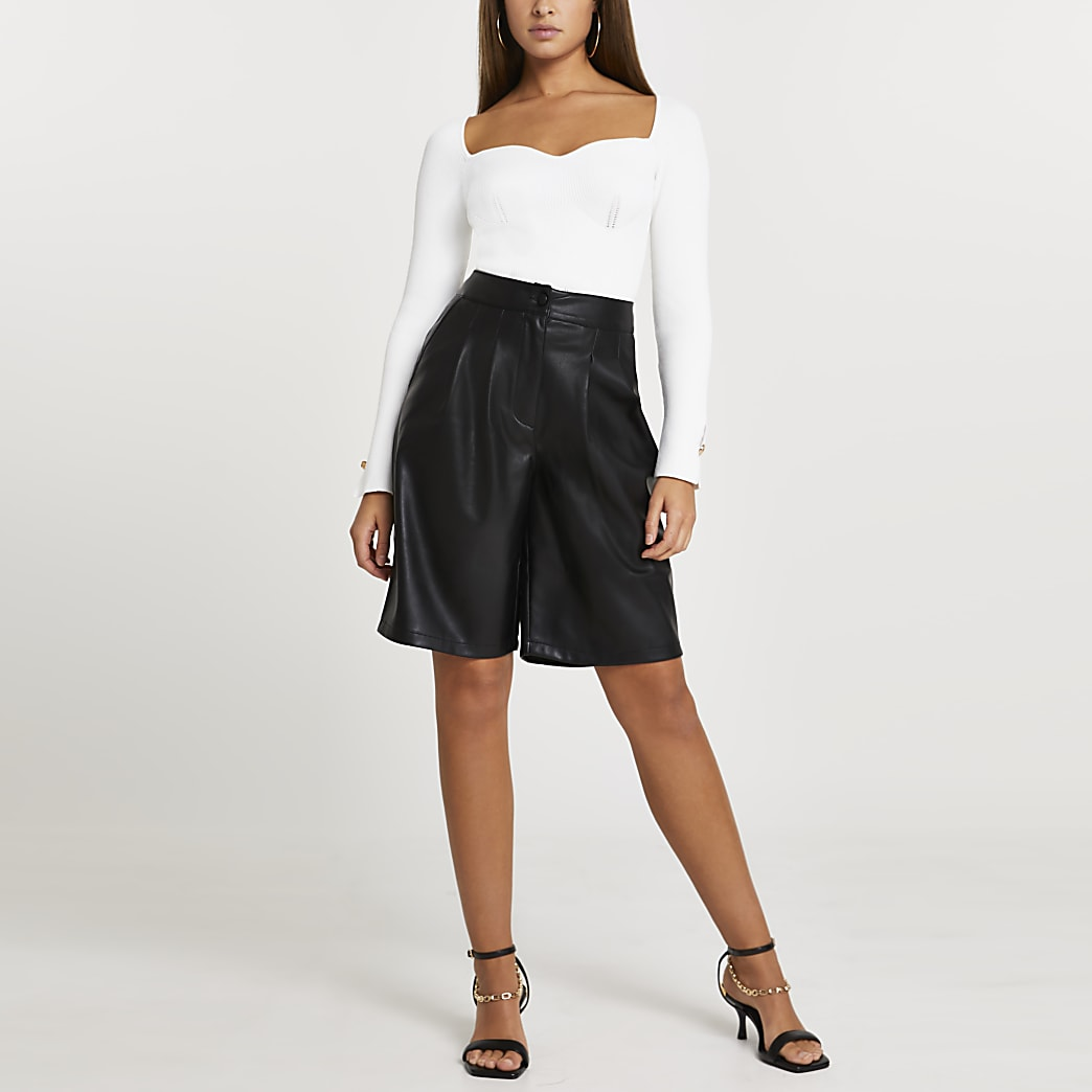 Black faux leather pleated shorts
